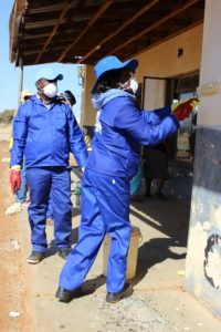 The Honourable Motlalepula Rosho and the CEO for NWDC, Mr Mojalefa Nale applying their painting skills at Letsomane Creche in Setlopo